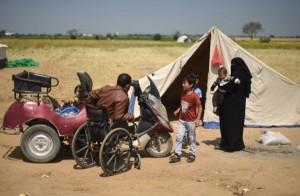 Fadi Abu Salah, com sua família em um campo de refugiados